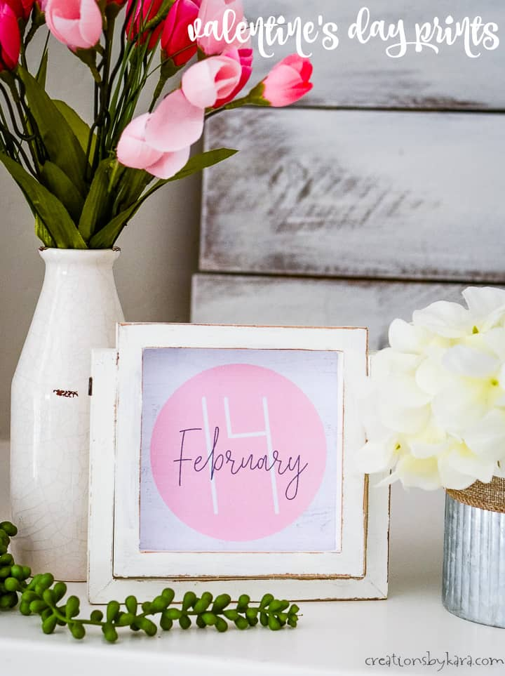 pink valentines day sign in a frame