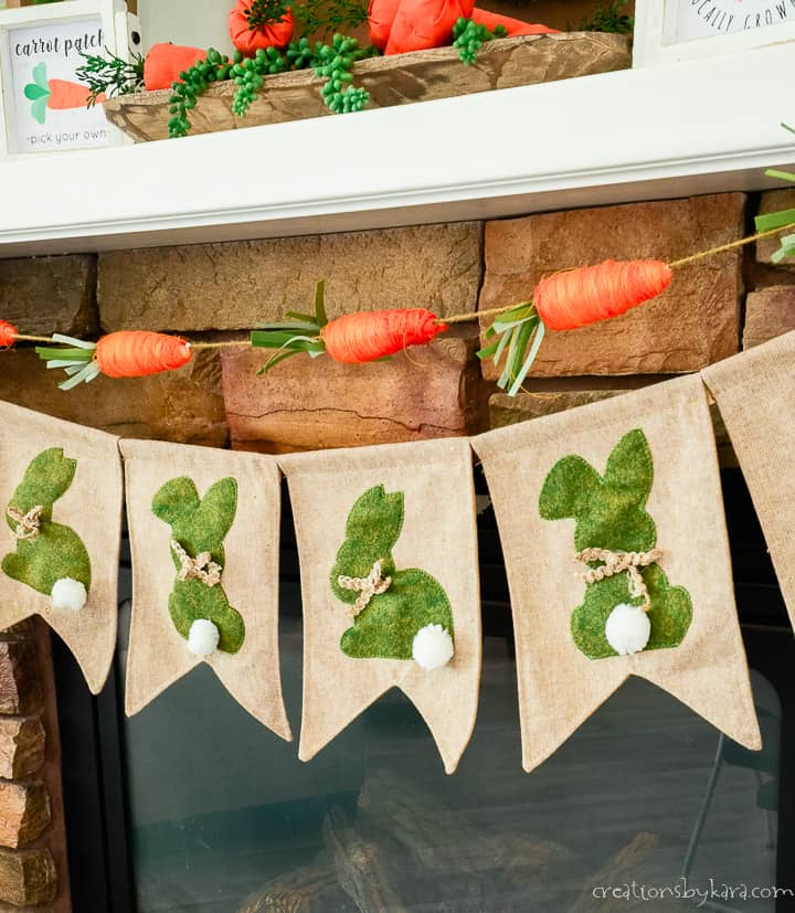 moss and burlap bunny banner with a string of jute carrots