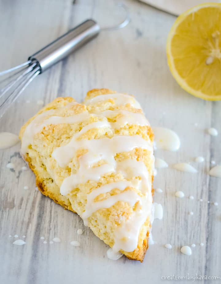 overhead shot of lemon cream scone drizzled with glaze