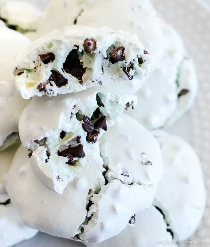 mint chocolate chip meringue cookies on a plate