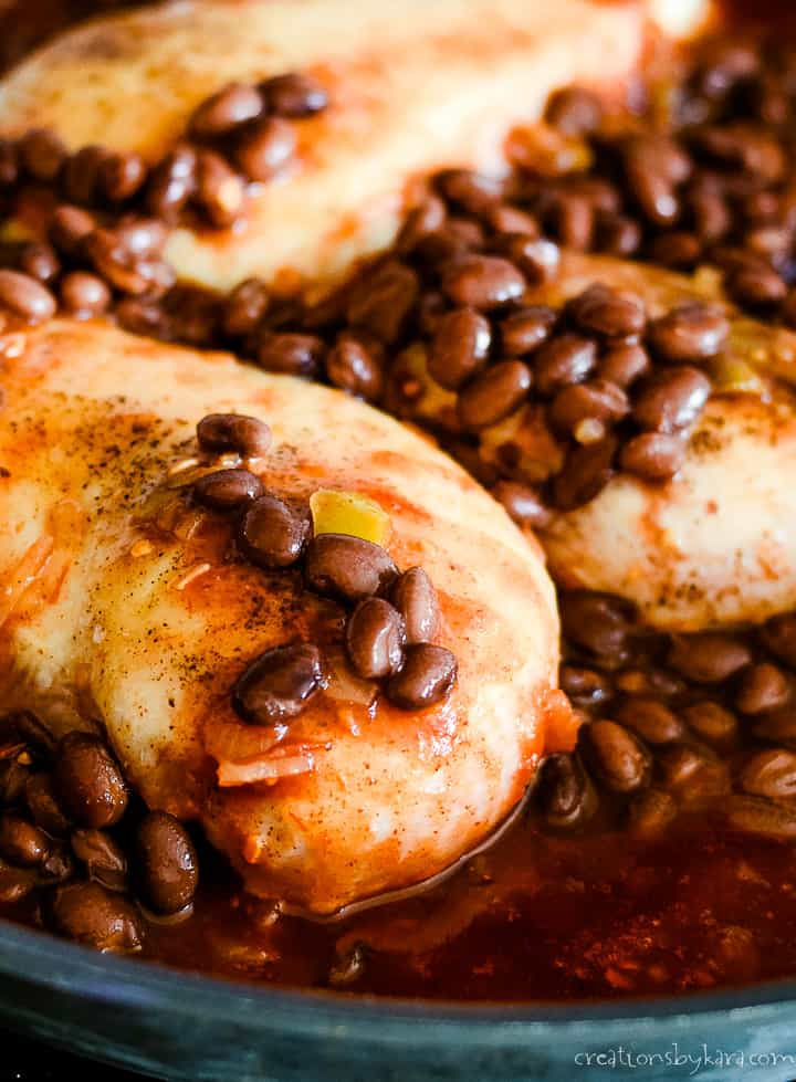 skillet with black beans and salsa chicken