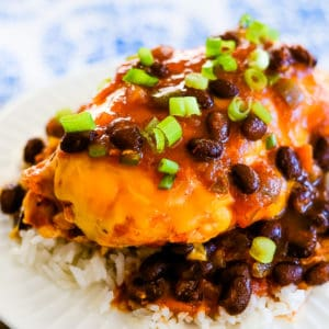 plate of rice topped with black bean salsa chicken