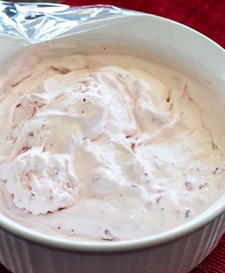 homemade strawberry ice cream after being churned
