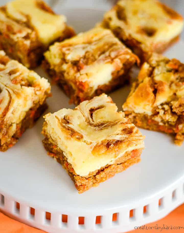 overhead shot of carrot cake bars on a cake stand