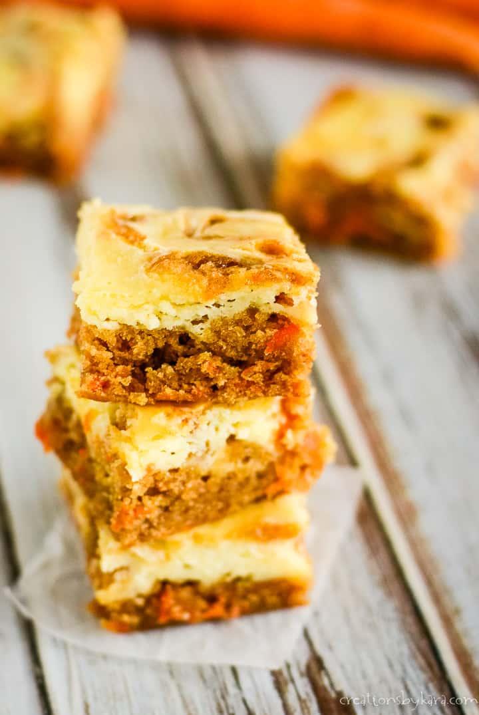 stack of carrot cake cheesecake bars