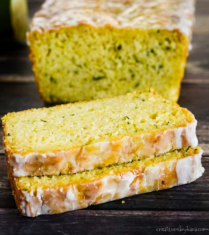 close up shot of slices of glazed lemon zucchini bread