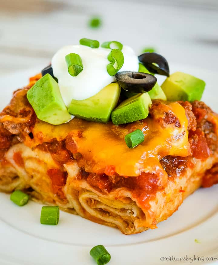 close up of spanish lasagna recipe on a plate with garnishes
