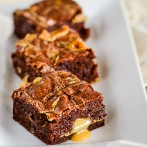 three brownies on a white tray