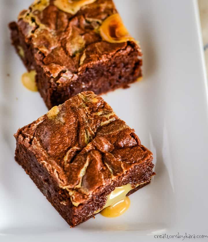 overhead shot of ooey gooey dulce de leche brownies on a tray