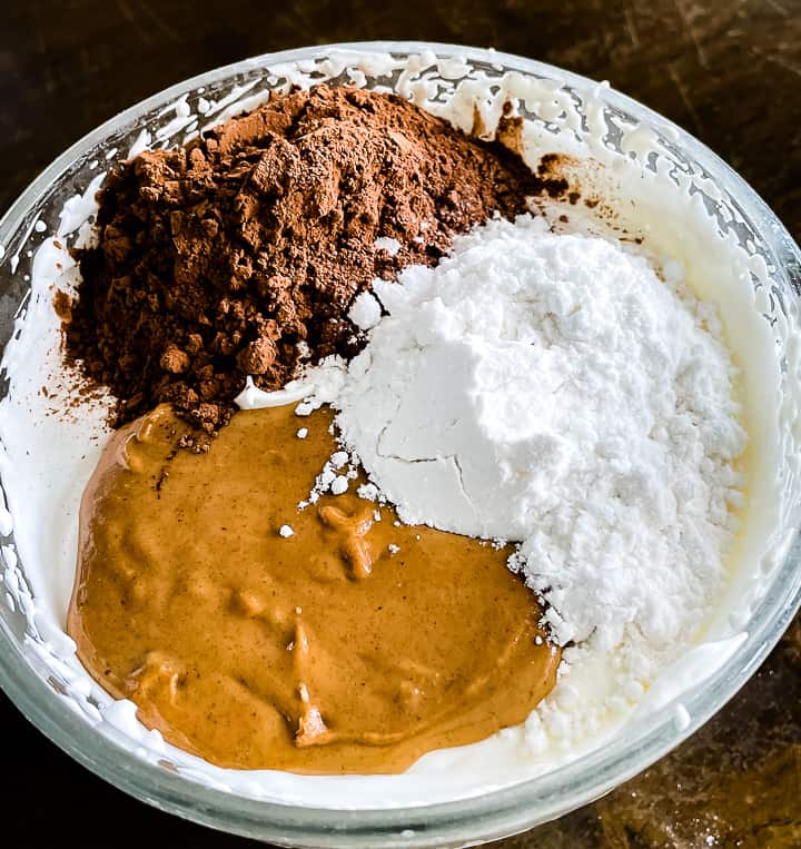 bowl of ingredients for low carb chocolate peanut butter mousse