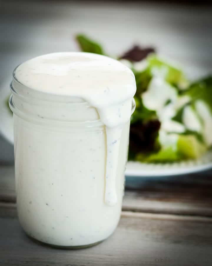 low carb ranch dressing spilling over the edge of a glass jar