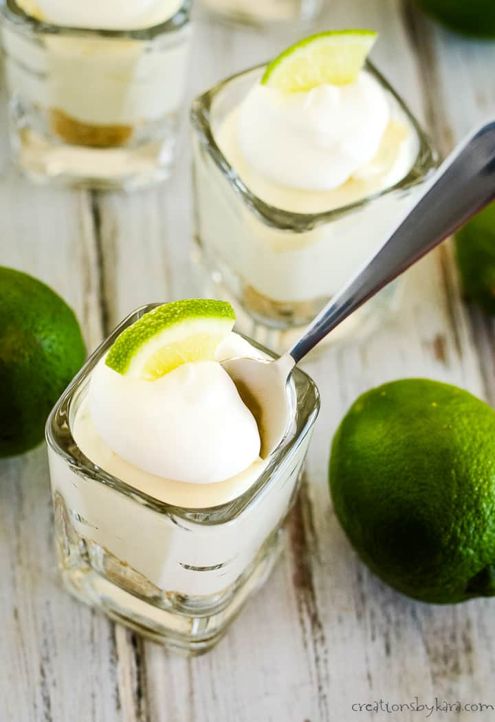 overhead shot of mini key lime cheesecake with a spoon in it