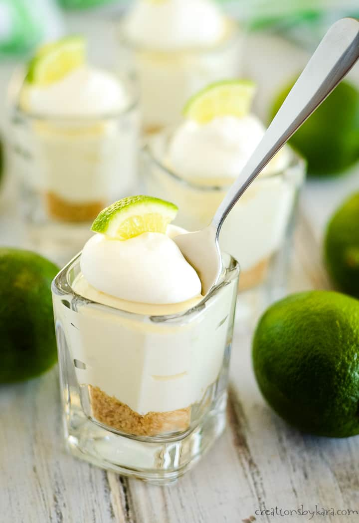fresh limes and no bake mini key lime pies, one with a spoon