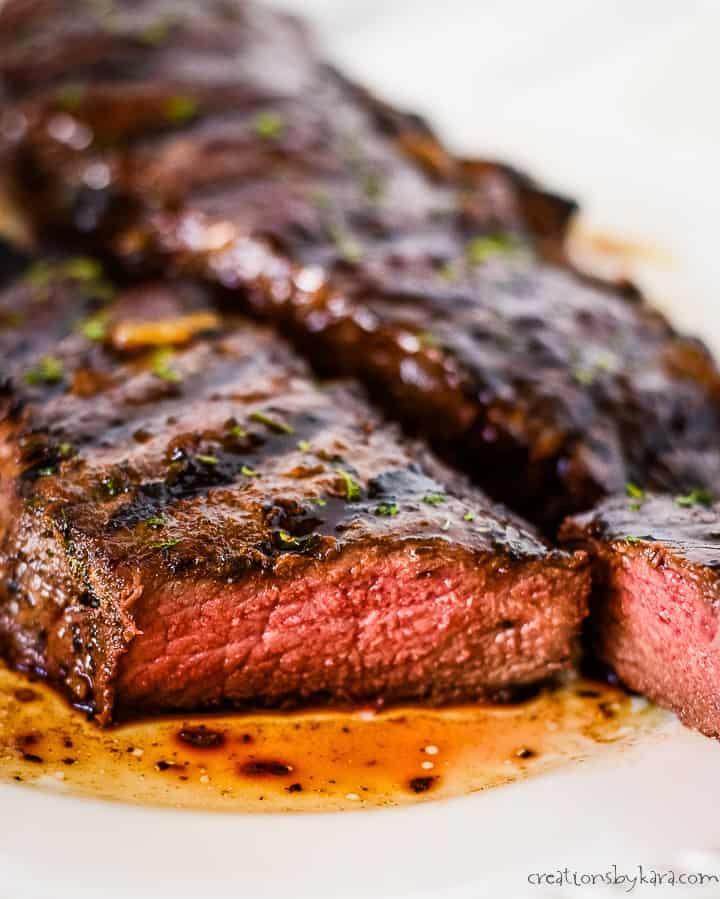 sliced marinated steak on a white plate