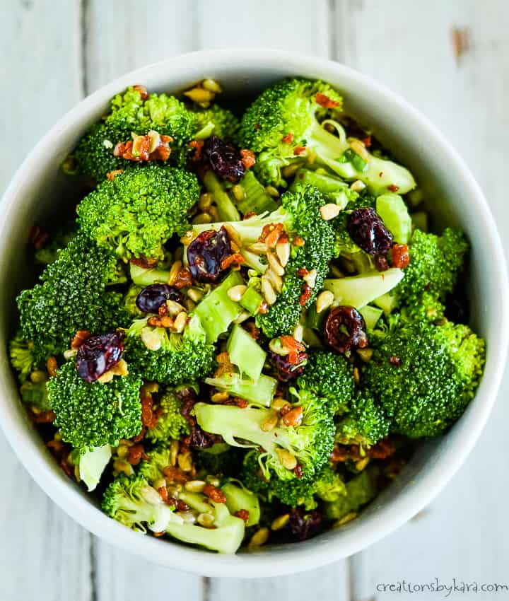 overhead shot of the best broccoli salad recipe with bacons and craisins