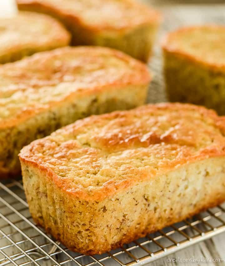 loaves of buttermilk banana bread on wire racks
