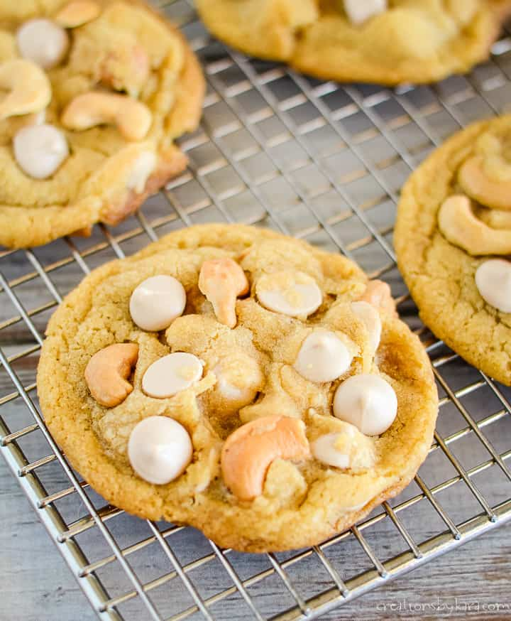 caramel chip cookies with cashews on a cooling rack