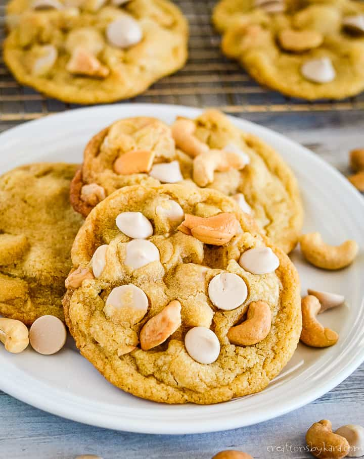 plate of browned butter caramel cookies with cashews