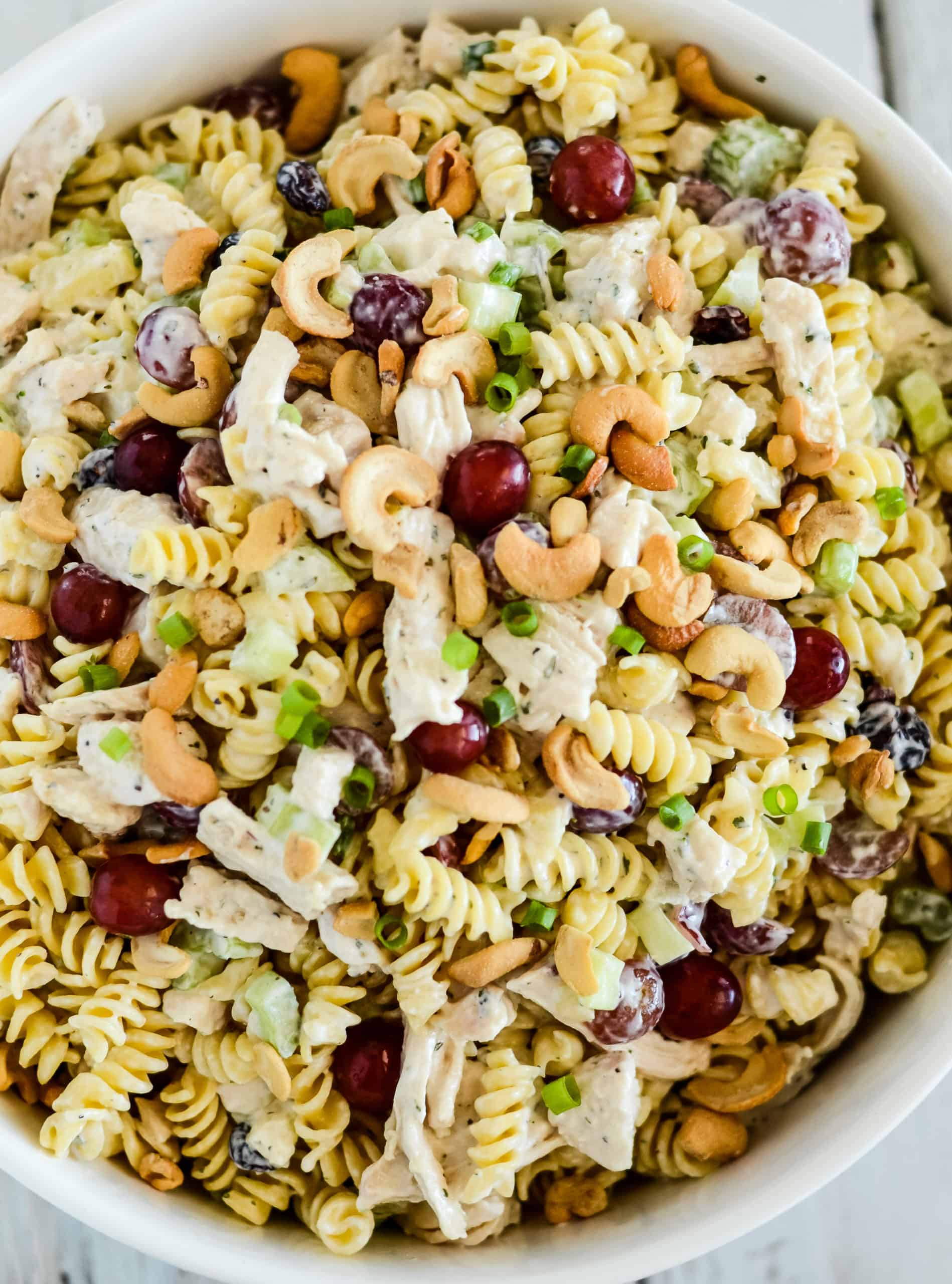 overhead shot of creamy chicken pasta salad with grapes