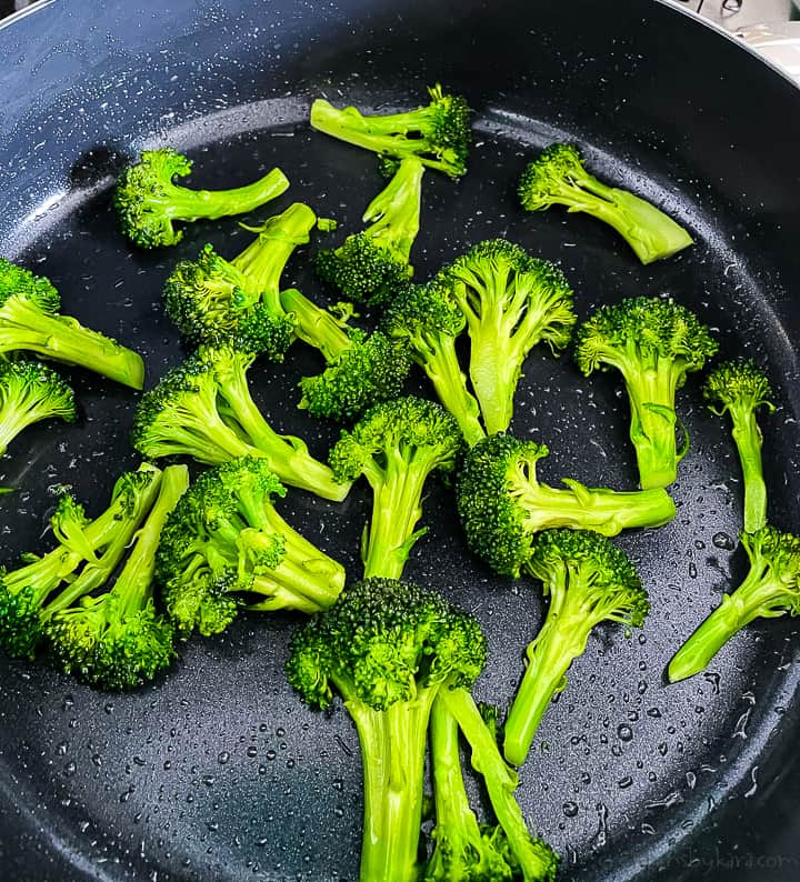 broccoli being sauteed in butter