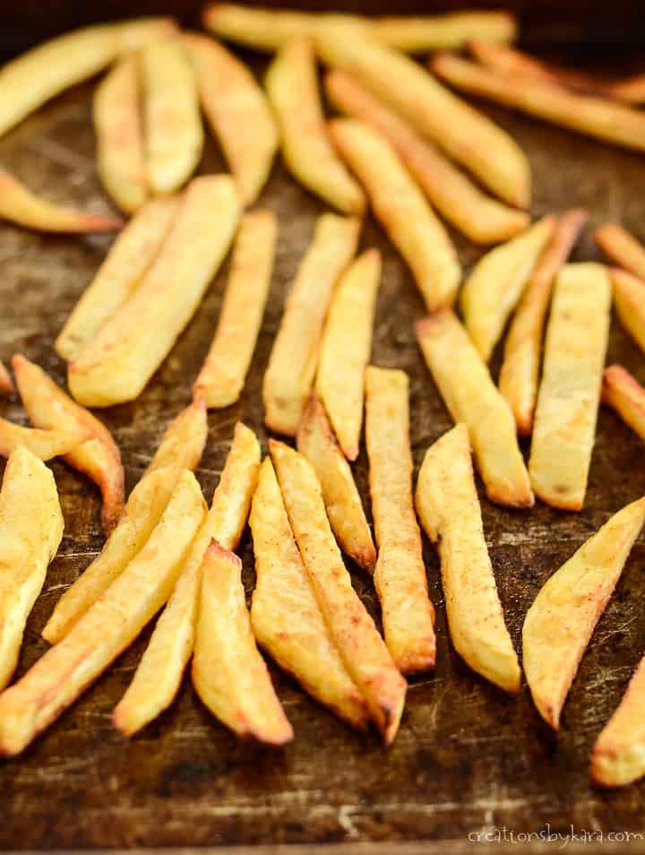 pan of baked steak fries seasoned and crispy