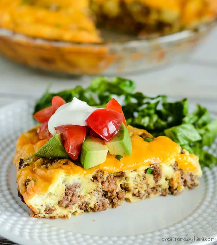 slice of keto taco pie on a plate with garnishes