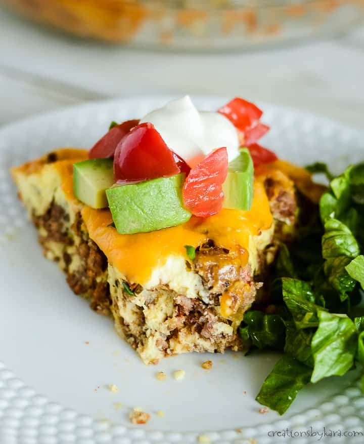 keto taco pie on a plate with a bite taken out of it