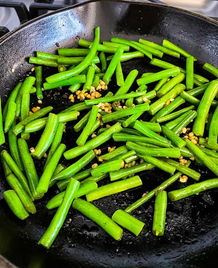skillet of green beans for green bean beef casserole