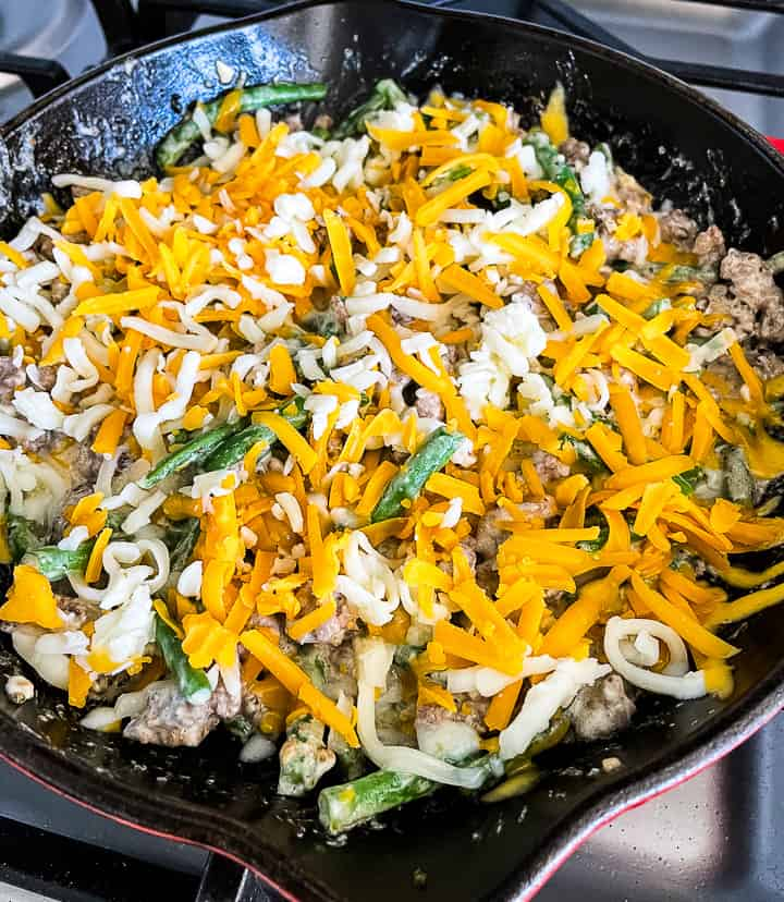 cheese sprinkled over ground beef green bean casserole