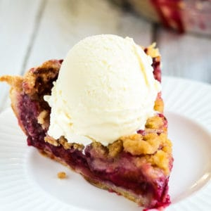 fresh plum pie topped with vanilla ice cream