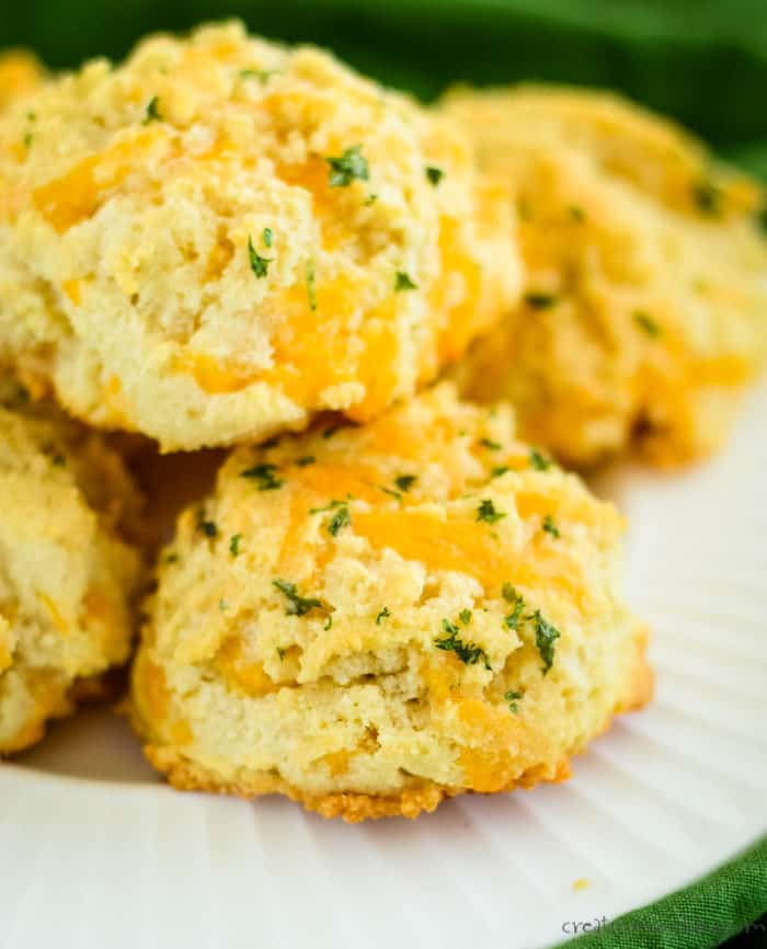 plate of keto cheddar biscuits with garlic butter glaze